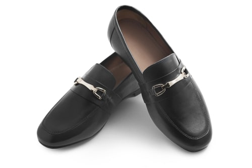 A pair of black horsebit loafers