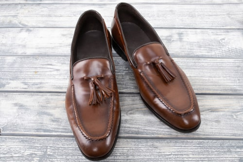 example of a brown leather tassel loafers