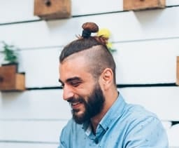 top knot with undercut and beard