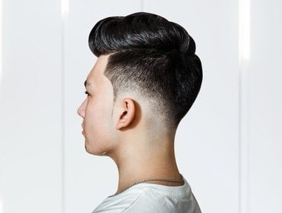 side view of pompadour with low fade