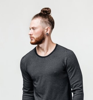man bun with an undercut fade