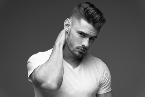 Wavy pompadour with a low fade