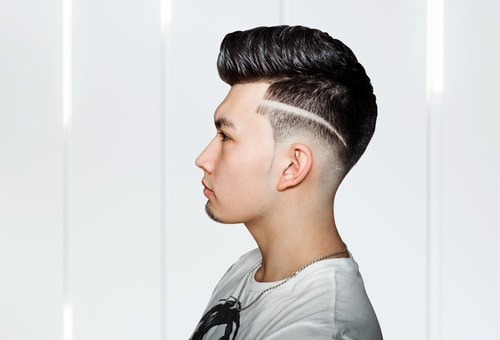 classic pompadour with a line design