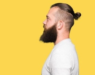 neat manbun with undercut and beard