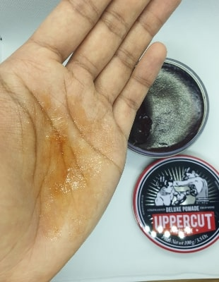 example of the uppercut deluxe pomade on the palm